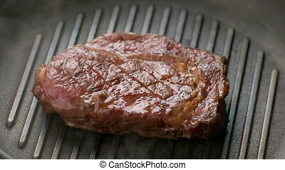Meat is frying on pan.