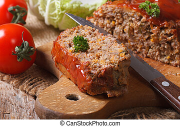 meat loaf close-up on a cutting board. horizontal - meat...