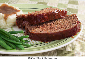 The ultimate comfort food… meat loaf prepared with ground beef, grated carrots, bread crumbs, and herbs and spices. Served with fresh green beans, mashed potatoes, and gravy.