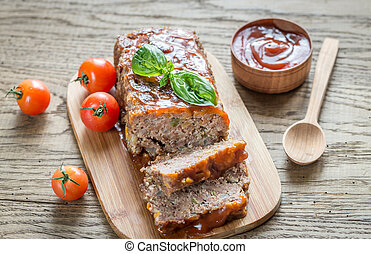 Meat loaf with barbecue sauce on the wooden board