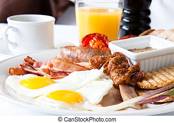 Meat Lover\'s Breakfast - Breakfast of fried eggs, pinque...