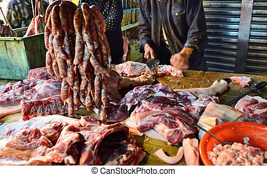 Meat Market - Meats being butchered at a Taiwanese food ...