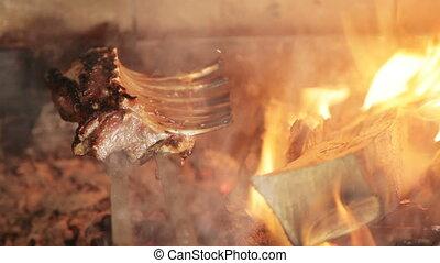 Meat on ribs in fire