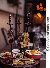 Meat on skewer fry with a cooking gas torch flomber....
