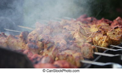 meat on skewers with smoke. 2 shots - meat on skewers...