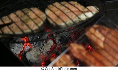 Meat on the grill with flames closeup