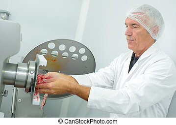 meat packer using a grinder