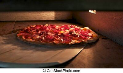 Meat pizza being baked. Delicious food cooked in oven.