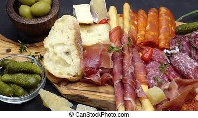 meat plate - salami and chorizo sausage close up on a wood...