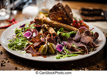 Meat platter for two: Dry-aged beef brisket, duck fillet, ...