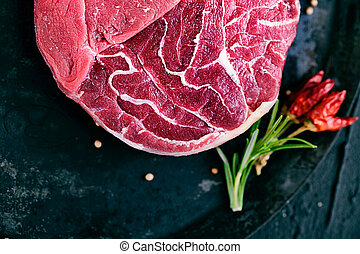 Raw meat - Meat. Raw meat. Beef steak on  black with herbs