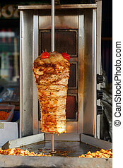 Meat roasted on a vertical spit before making a shawarma