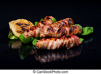 Meat rolls on a black background.