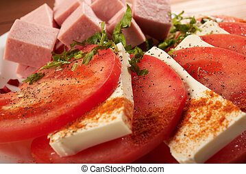 meat salad with tomato and cheese