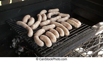 Meat sausages are grilled - Bratwurst sausages cooking on a...