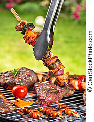 Meat skewer on grill