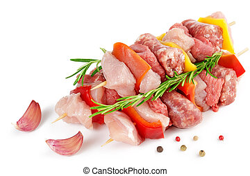 meat skewers, garlic and peppercorns isolated on white