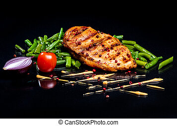 Meat steak on a black background.