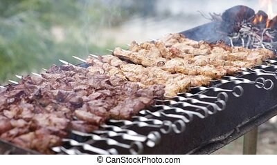meat strung on skewers. a lot of shish kebab is grilled...