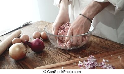 Meat stuffing for cutlets or meatballs in a stainless steel....