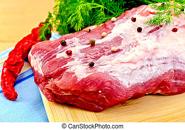 Meat whole piece with spices on the board