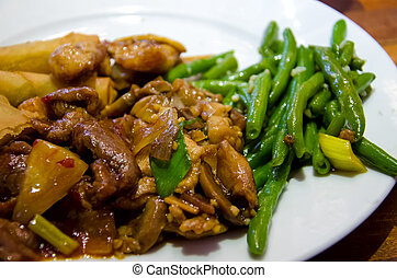 Meat with green beans.