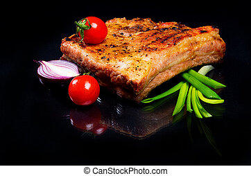 Meat with ribs on a black background.