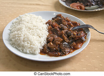 Meat with rice on a plate