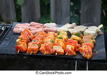 Meat with vegetables grilled on a grill