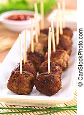 Meatball appetizers with toothpicks (Selective Focus, Focus ...