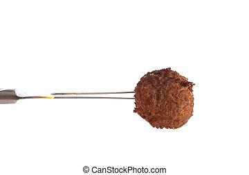 Meatball on a fork - Fresh baked meatball on a fork aginst a...