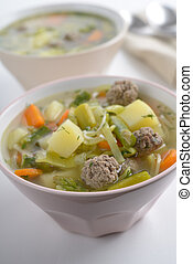 Meatball soup in two bowls