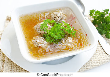 Meatball soup - meatball soup bowl with fresh green parsley