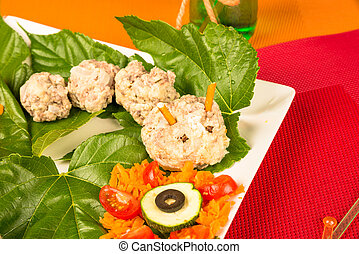 Meatball worm served with vegetables, a creative kid meal