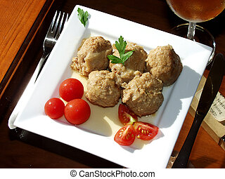 meatballs in onion sauce whit cherry tomatoes