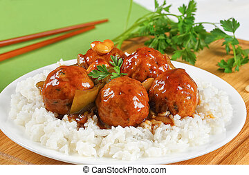 meatballs in sauce served with rice - meatballs stewed in ...