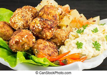 Meatballs on a plate decorated with vegetables