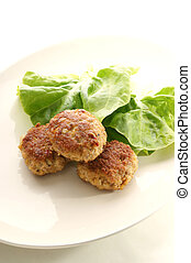 meatballs on a plate with salad