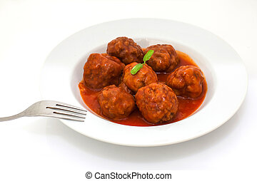 Meatballs - meatballs in tomato sauce served on white tray
