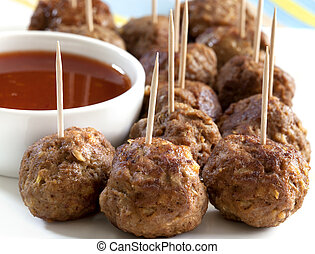 Meatballs - Meatball appetizers, with a dipping sauce.
