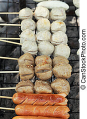 Meatballs skewers on the grill