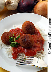 meatballs with home made spaghetti on a plate