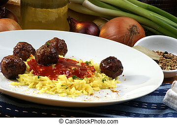 meatballs with organic curry rice on a plate