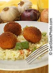 meatballs with organic rice on a plate
