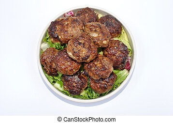 meatballs with organic salad on a plate