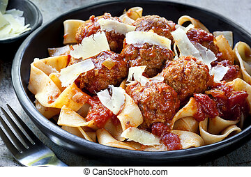 Meatballs with pappardelle pasta and shaved parmesan.