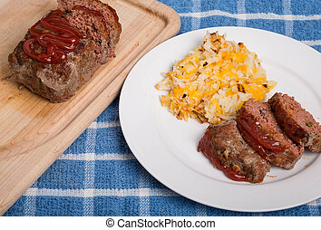 Meatloaf dinner with hash brown potatoes