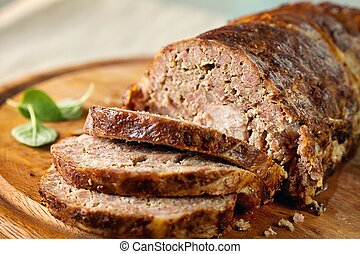 Meatloaf (beef) with salad on a wooden platter