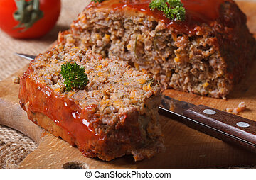 meatloaf with ketchup close-up on chopping board