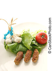 meatrolls on a plate with salad